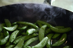 Cooking snap peas. Pan filled with steamed snap peas Stock Photo