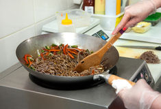 Cooking Soba noodles with vegetables Stock Photos