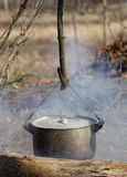 Cooking in sooty cauldron on campfire. At spring forest Royalty Free Stock Images