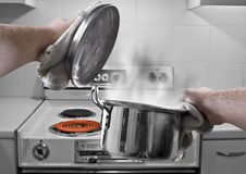 Cooking Soup. A photo montage of holding a soup pan in the kitchen Royalty Free Stock Photos