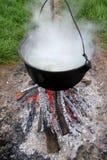 Cooking soup on cauldron Stock Photos