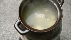 Cooking soup with coal briquette oven stock video footage