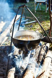 Cooking soup in hiking bowler over campfire Stock Image