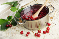 Cooking sour cherry jam Royalty Free Stock Photos
