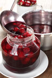 Cooking sour cherry jam Royalty Free Stock Image