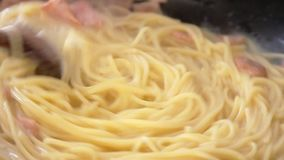 Cooking Spagetti Carbonara stock video footage