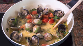 Cooking spaghetti alle vongole clams Stock Photo