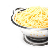 Cooking spaghetti in a colander metal Royalty Free Stock Photos