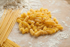 Cooking spaghetti and macaroni at home. Royalty Free Stock Images