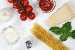 Cooking spaghetti noodles pasta: ingredients on wooden board Stock Images