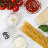 Cooking spaghetti noodles pasta meal ingredients on wooden board Stock Photo