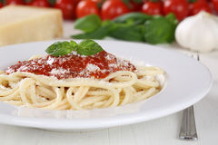 Cooking spaghetti noodles pasta: prepared meal with tomato sauce Royalty Free Stock Photo