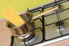 Cooking spaghetti pasta in a pot Stock Photo