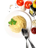 Cooking spaghetti on a plate with vegetables on a white background Stock Image