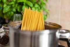 Cooking spaghetti in a pot.  stock images