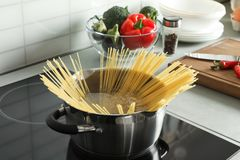 Cooking spaghetti in pot. On electric stove stock photography