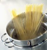 Cooking spaghettis in a stewpot Stock Photography