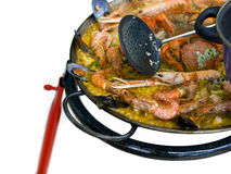 Cooking Spanish Paella. Close shot of a typical spanish paella being cooked outdoors Stock Image