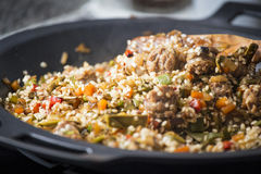 Cooking a Spanish paella Royalty Free Stock Image