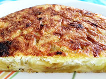 Cooking a Spanish potato omelet Royalty Free Stock Images