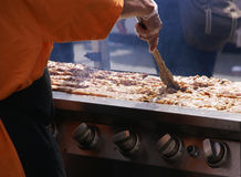 Cooking spicy kebabs at street fair, Stock Image