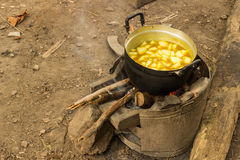 Cooking spicy soup in camping. Thai papaya spicy soup cooking by fire on pot in camping Stock Photos