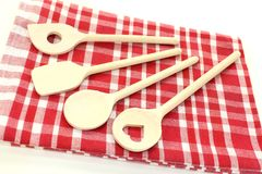 Cooking spoon. Wooden cooking spoon on a checkered napkin royalty free stock photo
