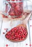 Cooking Spoon with Pink Peppercorns Stock Photo