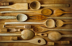 Cooking spoons. Cooking stirrers and spoons arranged on kitchen board royalty free stock images