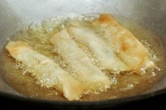 Cooking spring roll as four sheet wrap fried vermicelli and sli stock image