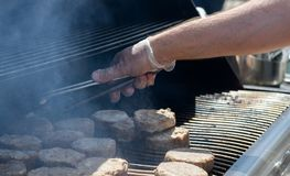 Cooking steaks on a hot grill Royalty Free Stock Photo