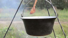Cooking stew at the camp stock video