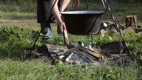 Cooking stew at the camp stock video footage
