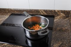 Cooking a stew. On an induction hob in the home kitchen Stock Images
