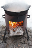Cooking stew on outdoor mobile brazier Royalty Free Stock Photography
