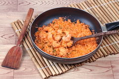 Cooking stir-fried grated coconut with shrimp for served. Royalty Free Stock Images