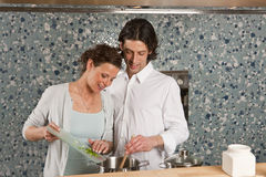 Cooking he is stiring in the pot Royalty Free Stock Image