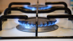 Cooking stove with blue gas turned on stock video footage