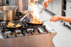 Cooking on the stove with fire Stock Photo