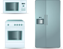 Cooking stove, microwave oven and refrigerator sid Royalty Free Stock Photo