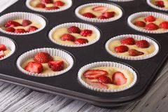 Cooking strawberry muffins in baking dish macro Stock Photo