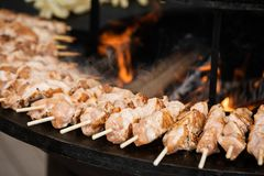 Cooking Street Food - Kebab Of Meat And Chicken, Impaled On A Wooden Skewer stock images
