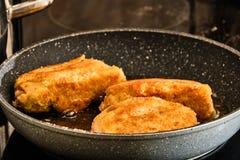 Cooking stuffed schnitzel stock images