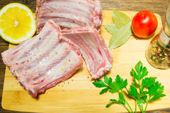 Cooking succulent ribs at home in the kitchen. Haute cuisine at home. kosher food during the holidays. Royalty Free Stock Photo
