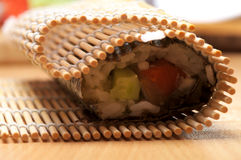 Cooking sushi roll Stock Images