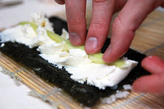 Cooking sushi roll Stock Photography