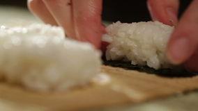 Cooking sushi roll. Macro shot. Stock Image