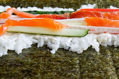 Cooking sushi rolls Royalty Free Stock Images
