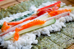 Cooking sushi rolls Royalty Free Stock Photography