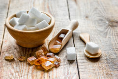 Cooking sweets set with different sugar lumps on rustic table background close up Stock Image